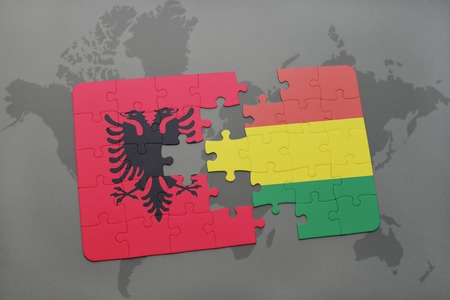 puzzle with the national flag of albania and bolivia on a world map background. 3D illustration Banco de Imagens