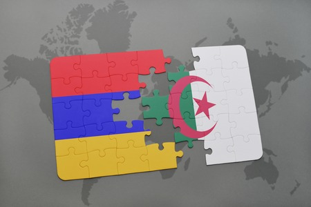 armenian: puzzle with the national flag of armenia and algeria on a world map background. 3D illustration