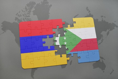 puzzle with the national flag of armenia and comoros on a world map background. 3D illustration Stock Photo