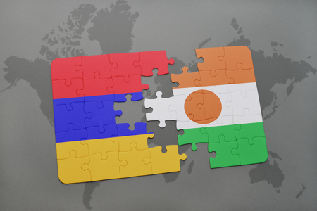 armenian: puzzle with the national flag of armenia and niger on a world map background. 3D illustration Stock Photo