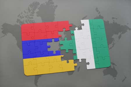 puzzle with the national flag of armenia and nigeria on a world map background. 3D illustration