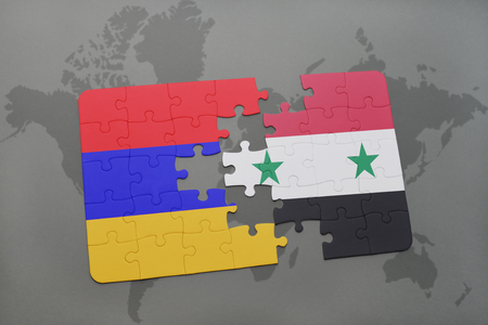 armenian: puzzle with the national flag of armenia and syria on a world map background. 3D illustration
