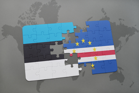 praia: puzzle with the national flag of estonia and cape verde on a world map background. 3D illustration Stock Photo