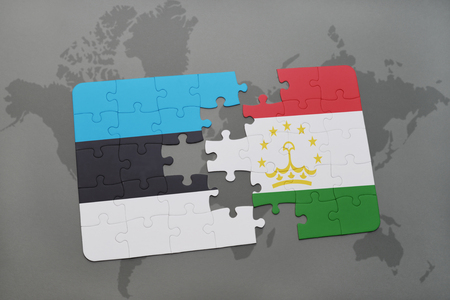 economy of tajikistan: puzzle with the national flag of estonia and tajikistan on a world map background. 3D illustration Stock Photo