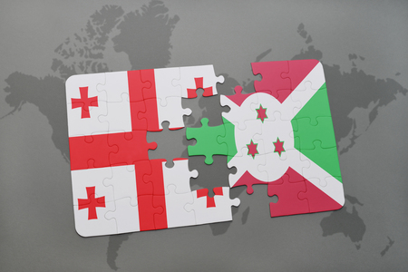 puzzle with the national flag of georgia and burundi on a world map background. 3D illustration Stock Photo