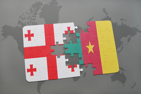 georgian: puzzle with the national flag of georgia and cameroon on a world map background. 3D illustration Stock Photo