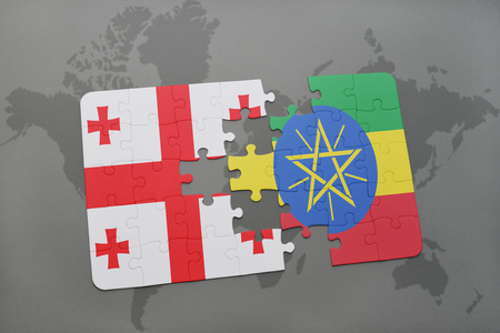 puzzle with the national flag of georgia and ethiopia on a world map background. 3D illustration Stock Photo