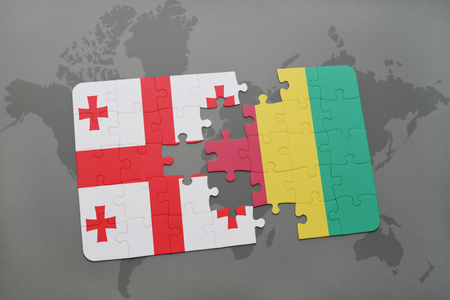 georgian: puzzle with the national flag of georgia and guinea on a world map background. 3D illustration Stock Photo
