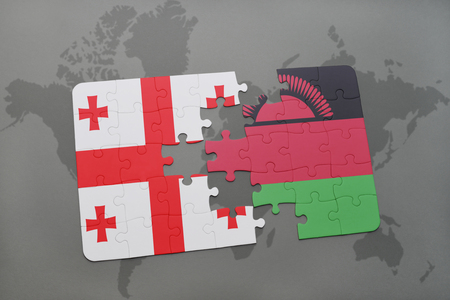 georgian: puzzle with the national flag of georgia and malawi on a world map background. 3D illustration