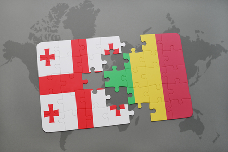 puzzle with the national flag of georgia and mali on a world map background. 3D illustration
