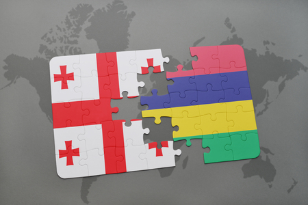 puzzle with the national flag of georgia and mauritius on a world map background. 3D illustration