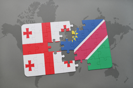 georgian: puzzle with the national flag of georgia and namibia on a world map background. 3D illustration Stock Photo