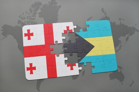 puzzle with the national flag of georgia and bahamas on a world map background. 3D illustration