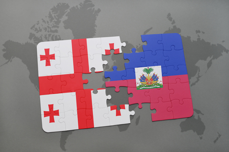 georgian: puzzle with the national flag of georgia and haiti on a world map background. 3D illustration