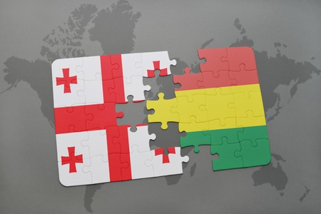 puzzle with the national flag of georgia and bolivia on a world map background. 3D illustration Imagens