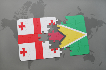 puzzle with the national flag of georgia and guyana on a world map background. 3D illustration Stock Photo