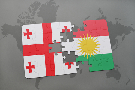 puzzle with the national flag of georgia and kurdistan on a world map background. 3D illustration