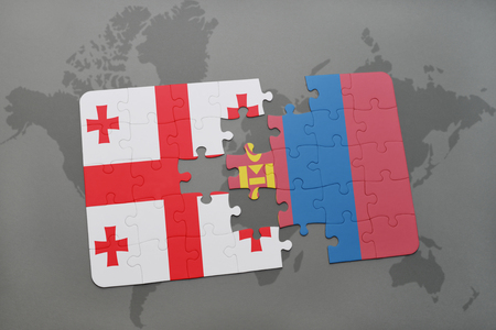 mongolia: puzzle with the national flag of georgia and mongolia on a world map background. 3D illustration