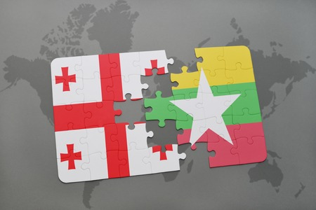 puzzle with the national flag of georgia and myanmar on a world map background. 3D illustration