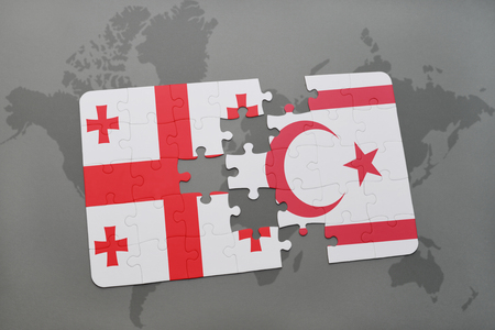 puzzle with the national flag of georgia and northern cyprus on a world map background. 3D illustration