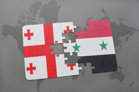 puzzle with the national flag of georgia and syria on a world map background. 3D illustration Stock Photo