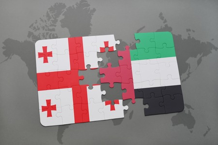 georgian: puzzle with the national flag of georgia and united arab emirates on a world map background. 3D illustration Stock Photo