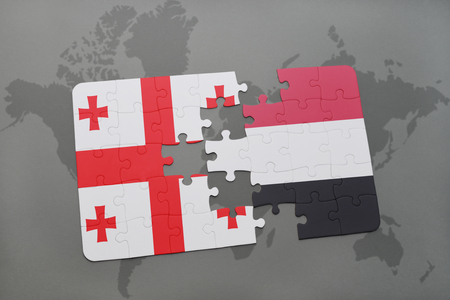 puzzle with the national flag of georgia and yemen on a world map background. 3D illustration