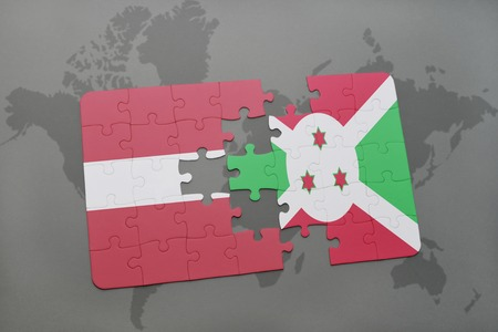 puzzle with the national flag of latvia and burundi on a world map background. 3D illustration
