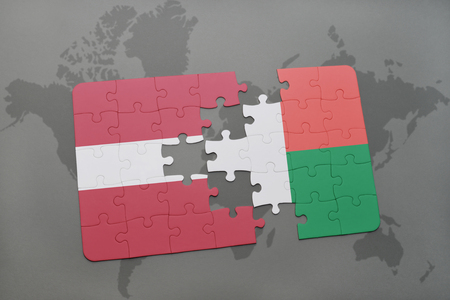 puzzle with the national flag of latvia and madagascar on a world map background. 3D illustration Stok Fotoğraf