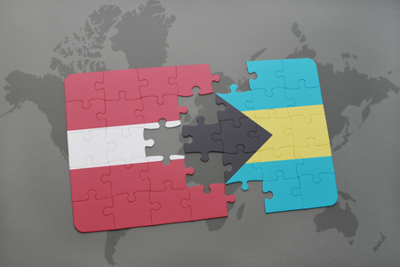 puzzle with the national flag of latvia and bahamas on a world map background. 3D illustration Stock Photo