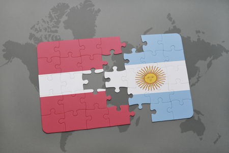 aires: puzzle with the national flag of latvia and argentina on a world map background. 3D illustration Stock Photo