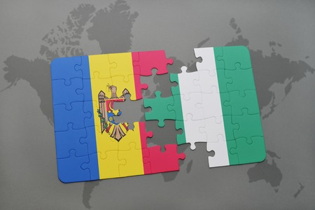 puzzle with the national flag of moldova and nigeria on a world map background. 3D illustration Stock Illustration - 76326180