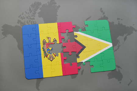 guyanese: puzzle with the national flag of moldova and guyana on a world map background. 3D illustration