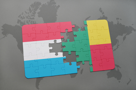 benin: puzzle with the national flag of luxembourg and benin on a world map background. 3D illustration Stock Photo