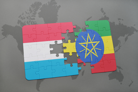 puzzle with the national flag of luxembourg and ethiopia on a world map background. 3D illustration Stock Photo