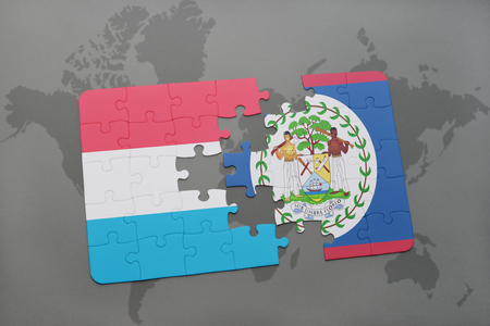 puzzle with the national flag of luxembourg and belize on a world map background. 3D illustration