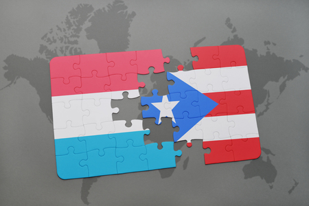 puzzle with the national flag of luxembourg and puerto rico on a world map background. 3D illustration Stock Photo