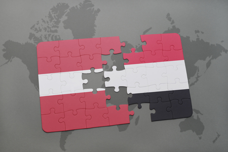 puzzle with the national flag of latvia and yemen on a world map background. 3D illustration
