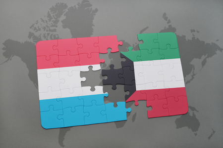 puzzle with the national flag of luxembourg and kuwait on a world map background. 3D illustration Stock Photo
