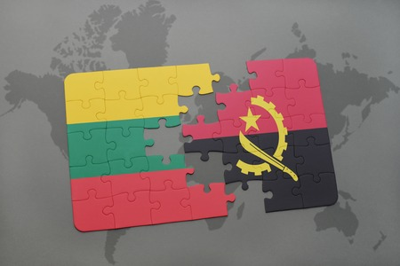 puzzle with the national flag of lithuania and angola on a world map background. 3D illustration Фото со стока