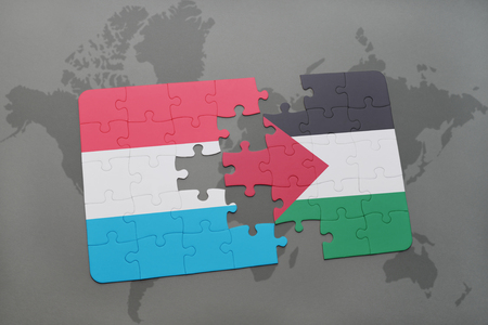 puzzle with the national flag of luxembourg and palestine on a world map background. 3D illustration Stock Photo