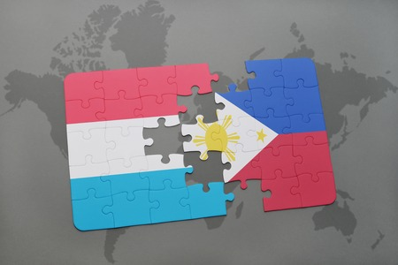 puzzle with the national flag of luxembourg and philippines on a world map background. 3D illustration Stock Photo