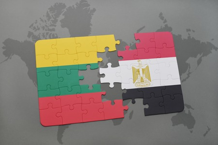 puzzle with the national flag of lithuania and egypt on a world map background. 3D illustration