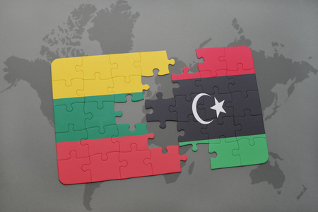 puzzle with the national flag of lithuania and libya on a world map background. 3D illustration