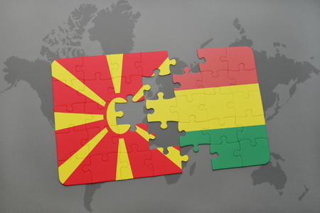 puzzle with the national flag of macedonia and bolivia on a world map background. 3D illustration Banco de Imagens