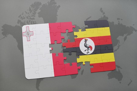 maltese map: puzzle with the national flag of malta and uganda on a world map background. 3D illustration