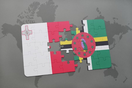 puzzle with the national flag of malta and dominica on a world map background. 3D illustration Stock Photo