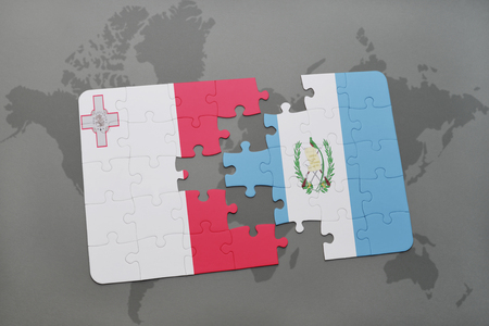 puzzle with the national flag of malta and guatemala on a world map background. 3D illustration