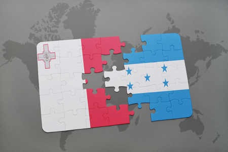 puzzle with the national flag of malta and honduras on a world map background. 3D illustration Stock Photo