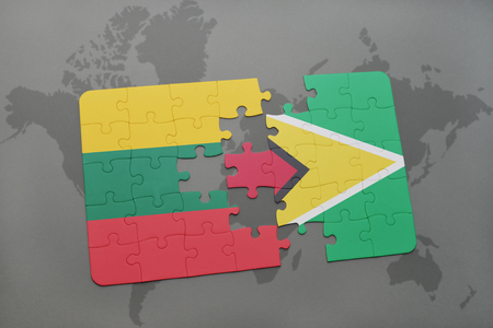 puzzle with the national flag of lithuania and guyana on a world map background. 3D illustration Stock Illustration - 76237499